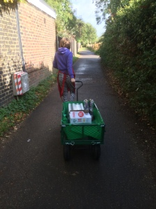 Ellen reluctantly pulling the trolley...